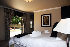 Relax in stunning formal gardens around the outdoor pool at Accolades Accommodation and Wedding Venues in Midrand