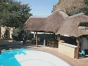 Gym, pool table and bar at Morning, Noon & Night bed and breakfast accommodation in Alberton
